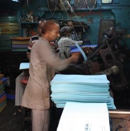 Men running printing press in Old Delhi