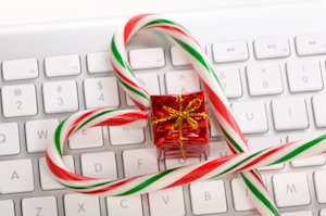 Candy canes and gift bof on keyboard